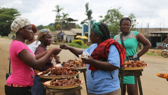 Women buying bushmeat at a food stall.