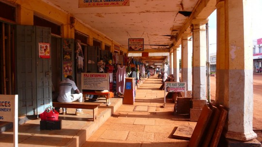 Outdoor shopping arcade with business adverts