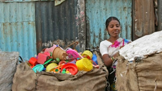 Closing sacks of sorted plastic for recycling at the Banvari Compound at Dharavi.Credit Meena Kadri. Creative Commons. http://creativecommons.org/licenses/by-nc-nd/2.0/deed.en_GB