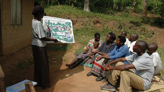 A Village Health and Conservation Team volunteer at Bwindi gives a group talk to her community (Photo: CTPH)
