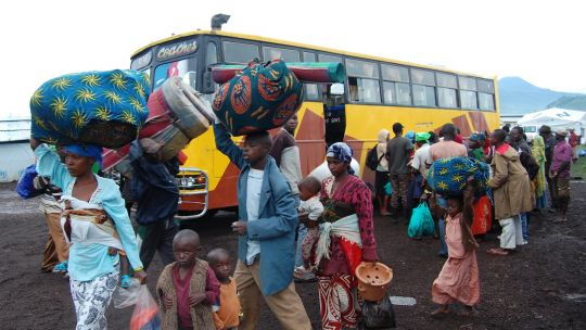 Refugees from conflict in the Democratic Republic of the Congo leave the Nyakabande transit camp in Uganda for an eight-hour journey to a refugee settlement (Photo: Andy Wheatley/DFID, Creative Commons via Flickr)