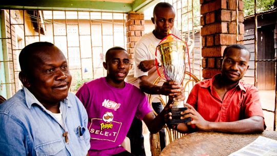 Congolese refugees proudly display the cup they won in a football tournament for youths from refugee communities in Kampala (Photo: Stephen Luke, Creative Commons via Flickr)
