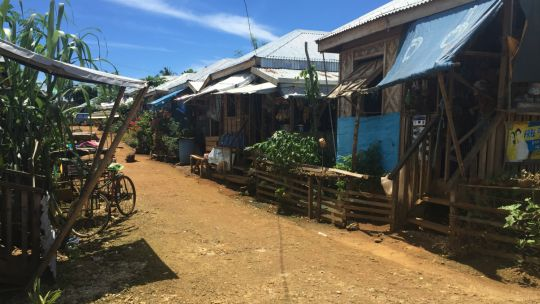 A resettlement site in Guiuan, in the Philippines, almost three years after super typhoon Haiyan with 'temporary' shelters that have been adapted by residents (Photo: Elizabeth Parker)