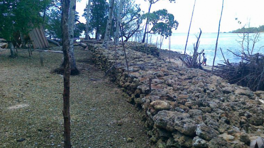 Wall made of stones that divides land and sea