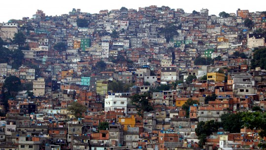 Hundreds of homes are crammed together up the side of a hill