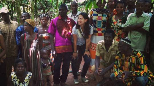 The author with cocoa farmers in Ghana. Farmers on average receive 3 per cent of a chocolate bar price and many are dependent on a single commodity for their livelihoods (Photo: Marisa Camargo)