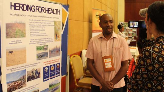 Conservation International's Amos Thiongo being interviewed in the CBA13 marketplace (Photo: IIED)