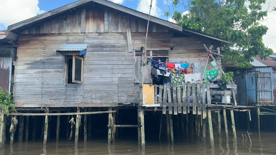 A house on stilts above a body of water.