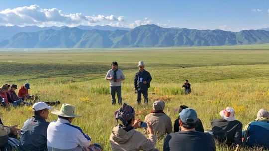 Participants on the International Network of Mountain Indigenous Peoples gather during the walking workshop in Suusamyr pasture, Kyrgyzstan (Photo: Alan Zulch)