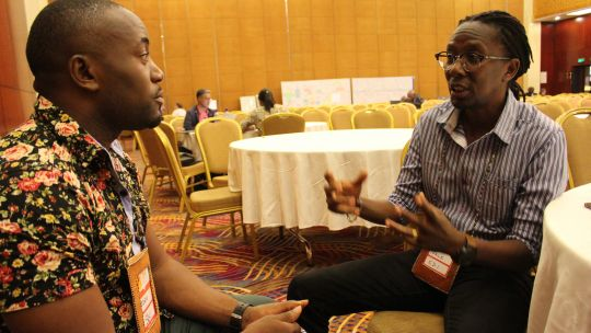 Edris Lubega, national leader of the National Slum Dwellers Federation of Uganda (left) and Jack Makau, director of Slum Dwellers International Kenya talk about their focus areas at CBA13 (Photo: IIED)