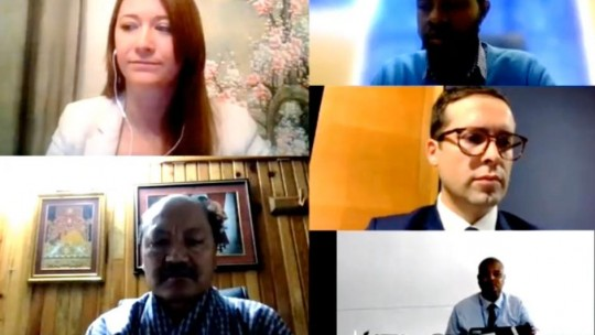 Video call showing five people