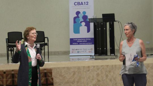 Former President of Ireland Mary Robinson (left) and IIED's director of climate change Clare Shakya talk to participants at CBA12 in Malawi (Photo: Teresa Corcoran/IIED)