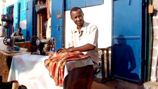 Sewing on the street in Djibouti. The informal sector still plays an important role in most of the LDCs (Photo: Charles Roffey, Creative Commons via Flickr)