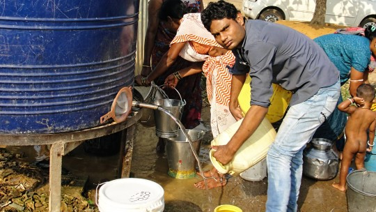 """There is no government-provided water connection in the Shivaji Nagar slum area of Raipur. Under UN definitions, a household has """"improved provision"""" for water even if it only has access to a public tap or standpipe. (Photo: indiawaterportal.org, Creative Commons via Flickr)"""