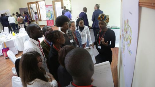 Participants in a Food Change Lab in Lusaka, Zambia gather around a presentation (Photo: Salimu Dawood)