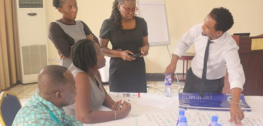 Stakeholders, including IIED's Fitsum Weldegiorgis (right), brainstorm to provide actionable solutions to challenges facing women in ASM during a workshop in Ghana (Photo: Friends of the Nation)